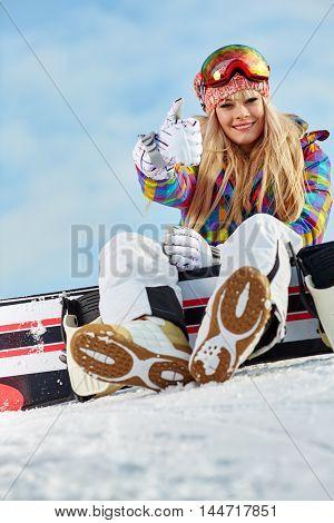 blonde snowboarder girl  on snow