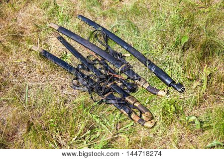 The old Cossack sabers lying on the grass