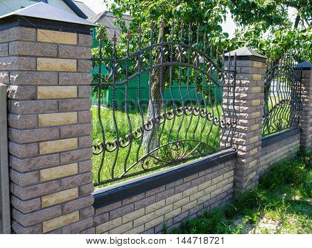 Fence with wrought elements protects private property