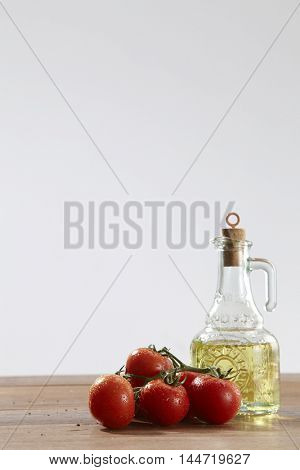 fresh tomatoes and bottle of olive oil