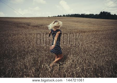 photo of young beautiful girl in autumn field