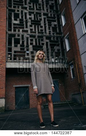 photo of young beautiful girl with urban background