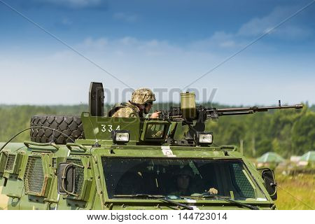 Lviv Ukraine - July 6 2016: Ukrainian-American joint military exercises near the Lviv rapid trident 2016. Gunner prepares to shoot a machine gun NSVT 12.7 on simulated enemy positions Lviv.Ukraine.