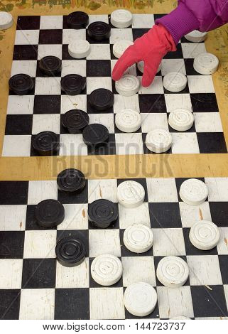 The game of checkers is black and white figures.