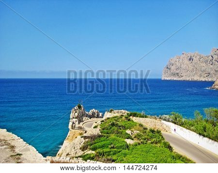180 degree curve of mountain road near ocean