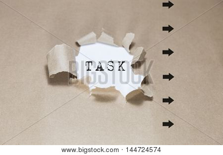 task written under Brown torn paper, business