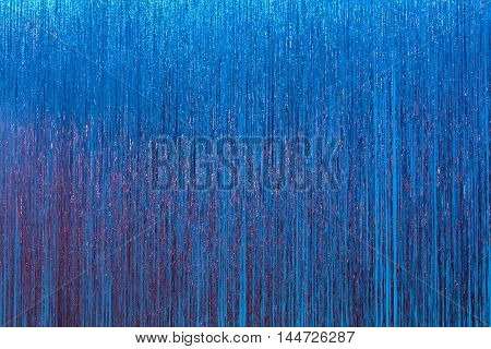 sparly blue steamers forming an exciting theatre stage curtain