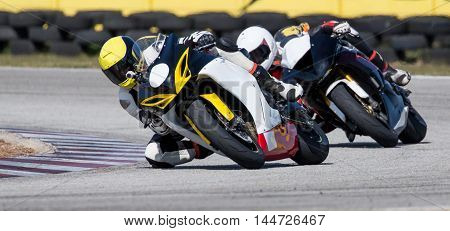 Two racing motorcycles on a sharp bend