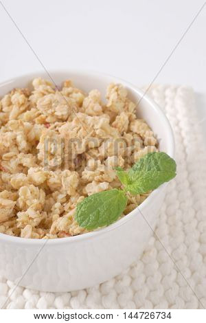 bowl of granola for healthy breakfast on white table mat