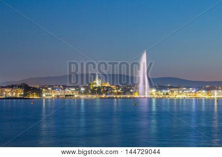 Geneva skyline and fountain at blue hour.
