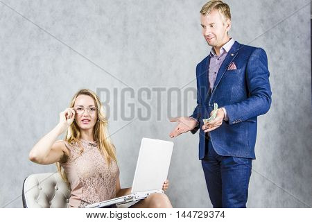 Woman boss and secretary of a man on a gray background