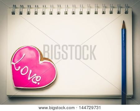 Love Heart Cookie shape on a blank book page.