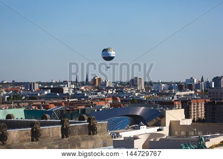 Berlin Germany - August 26 2016: World Balloon over the city view from a dome of Bundestag summer time