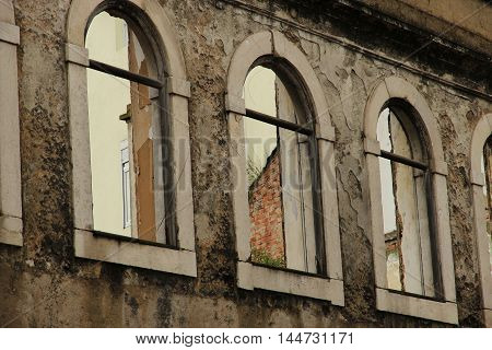 Facade with archs - window, abandoned, architecture, arch, reflected, dirty