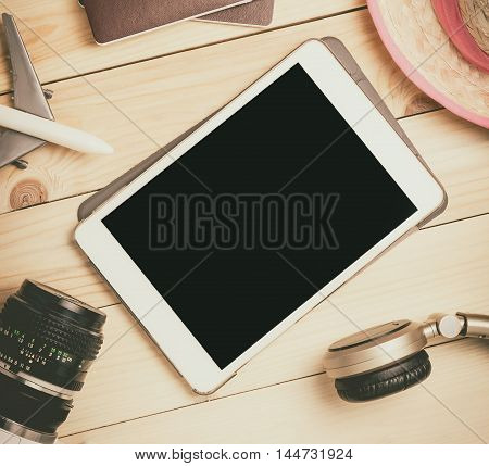 Blank tablet screen template mock up for summer travel equipments. Empty tablet screen for Vacation and travel agency website or travel advertisement.