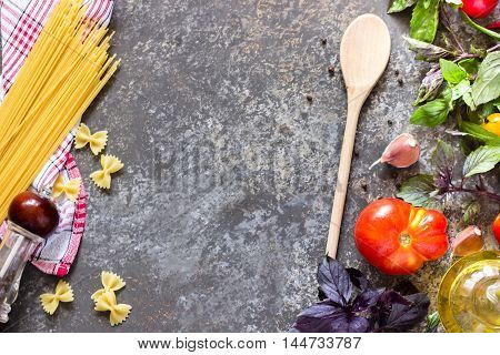 Italian Food Background, With Different Tomatoes, Basil, Spaghetti, Olive Oil, Garlic And Wooden Spo