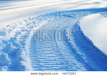 snowmobile track on snow