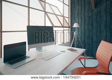 Closeup of creative designer workplace with blank laptop and pc screens bright swivel-chair floor lamp and framed windows. Mock up 3D Rendering