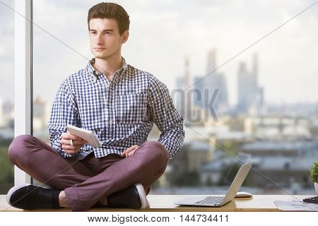 Man With Notepad On Windowsill