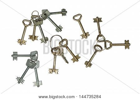 Keys sets, old and rusty. Isolation on a whiteness.