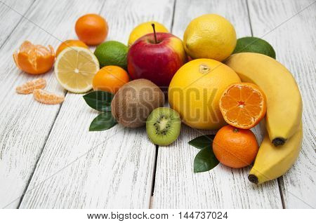 Fresh juicy citrus fruits on a white wooden background
