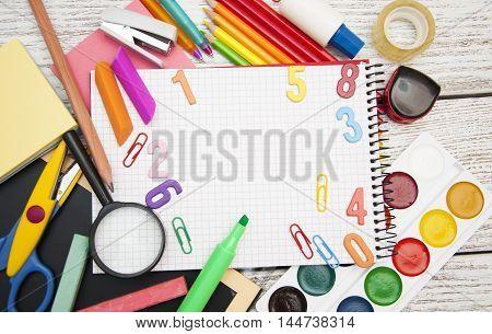 Assorted school supplies with a notebooks pencils pens scissors etc