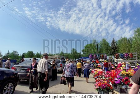 Nizhny Novgorod Russia. - May 10.2016. A lot of people on foot and in vehicles are to visit the cemetery onRadonitsa.