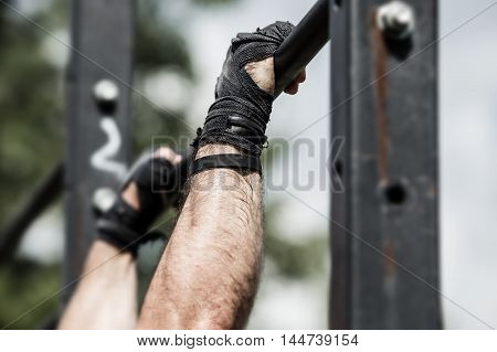 Athlete doing exercise on the horizontal bar