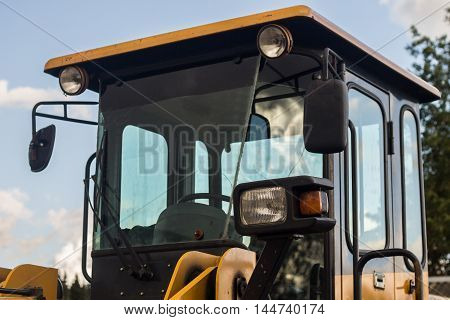 Heavy Bulldozer in the Parking lot at summer