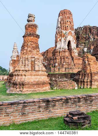 Ancient ruins of pagoda at Wat Phra Mahathat temple is a famous attractions in Phra Nakhon Si Ayutthaya Historical Park Thailand