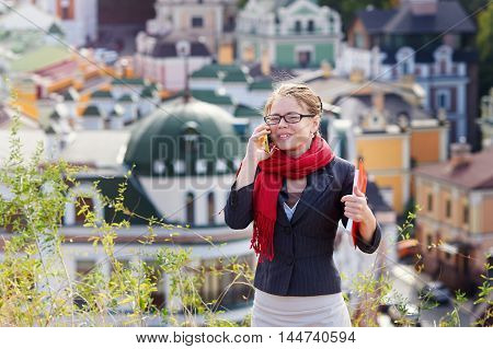 young woman with glasses talking on the phone.