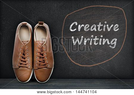 Creative writing text on black board and shoes