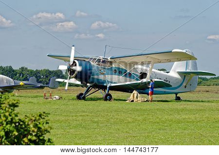 KHARKIV, UKRAINE - AUGUST 20, 2016: Antonov An-2 aircraft (USAF/DoD reporting name Type 22, NATO reporting name Colt) parked at the airport Korotych, Kharkov region, Ukraine on August 20, 2016