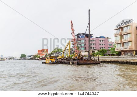 Bangkok Thailand - June 5 2016: Boat for driving piles into river at right hand side of Chao Phraya river.