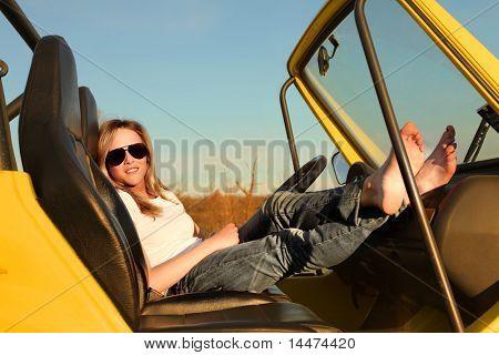Beautiful woman sitting in a car