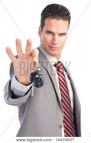 businessman holding car key. Isolated over white background