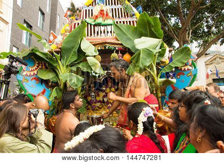 Paris France-August 28 2016 : The people participating in Ganesh Chaturti the birthday festival of the elephant headed Hindu deity in Paris France. Ganesh one of the most popular deities is believed to grant progress prosperity and wisdom.
