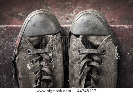 Grungy Sneakers Standing On Concrete Stairs