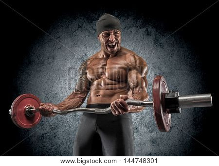 Handsome Power Athletic Man Bodybuilder Doing Exercises With Barbell.
