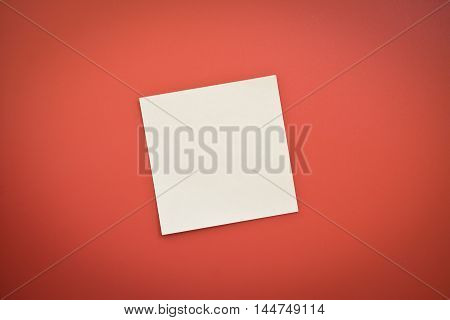 one yellow blank note over red background