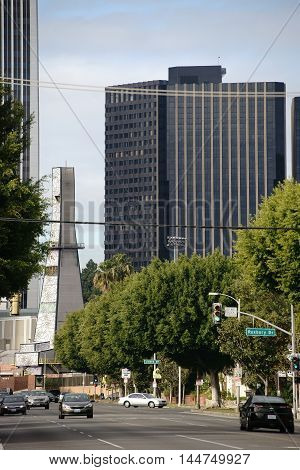 LOS ANGELES, UNITED STATES - DECEMBER 27: Road traffic on the Olympic Boulevard in the city center of Los Angeles with different skyscrapers on December 27, 2015 in Los Angeles.