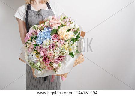 Florist At Work. Make Serenity Hydrangea Rich Bouquet. Flowers In Their Hands