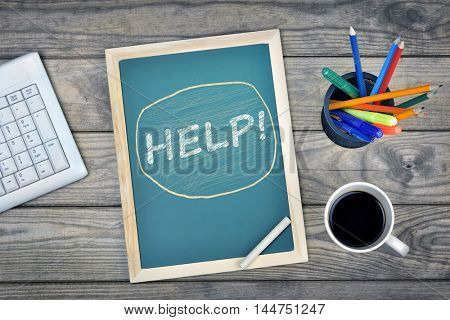 Help text on school board and coffee on desk