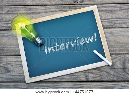 Interview text on school board and glowing light bulb