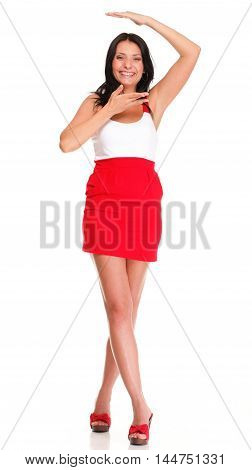 Portrait of sexy brunette in red gressi high heels posing istudio over white isolated