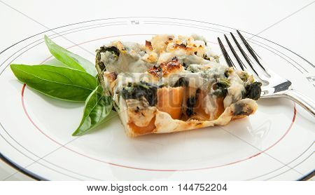 Baked feta cheese strada with spinach and basil.