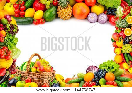 Frame from a variety of vegetables and fruits. Isolated space in the middle.