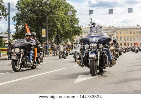 St. Petersburg, Russia - 13 August, Riding on motorcycles people with flags,13 August, 2016. The annual International Motor Festival Harley Davidson in St. Petersburg.