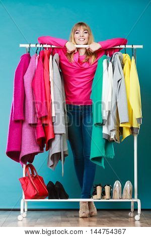 Woman Choosing Clothes To Wear In Mall Or Wardrobe