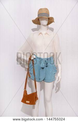 female clothing with hat, ,bag on mannequin